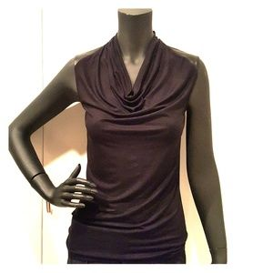 Sleeveless knit top with faux leather trim.